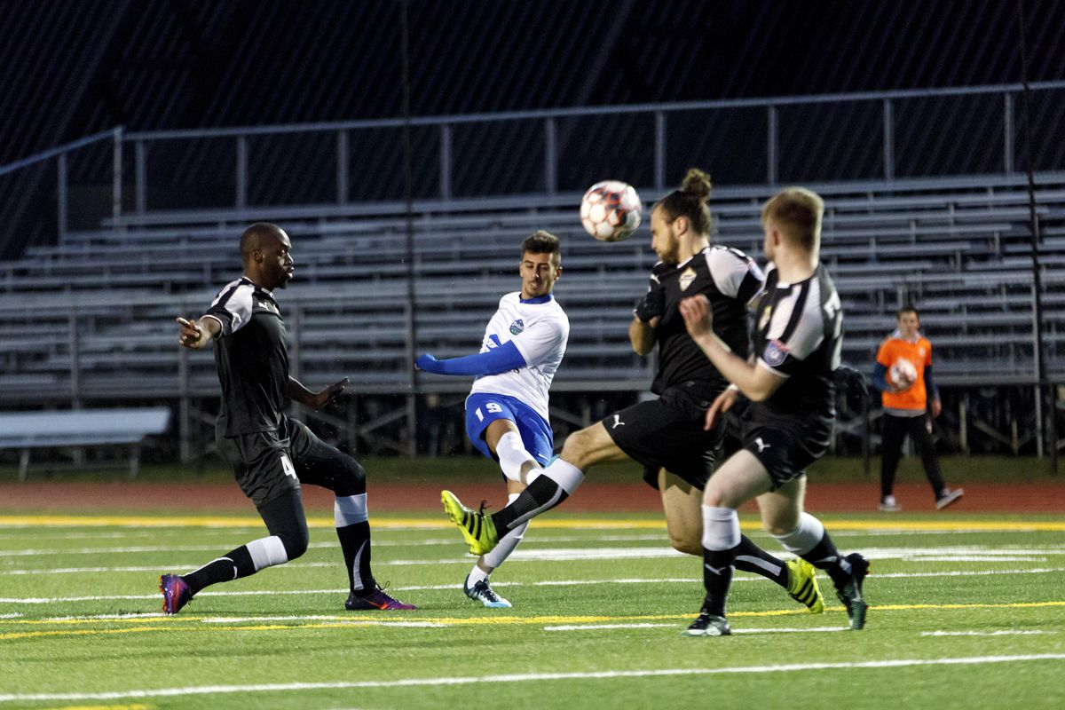 May 9, 2018 - Duluth, Minnesota, United States - Duluth FC Forward, Ricardo Ramos (19) scores a goal from 18 years out during the Duluth FC vs Dakota Fusion FC match at James S. Malosky Stadium.   (Photo by Seth Steffenhagen/Steffenhagen Photography)
