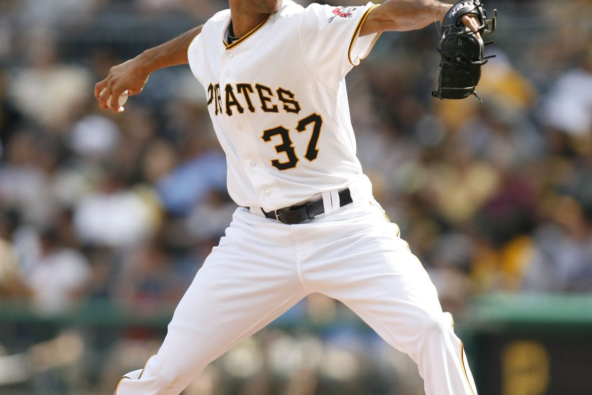 August 12, 2012; Pittsburgh, PA, USA; Pittsburgh Pirates relief pitcher Juan Cruz (37) pitches against the San Diego Padres during the eighth inning at PNC Park. The Pittsburgh Pirates won 11-5. Mandatory Credit: Charles LeClaire-US PRESSWIRE