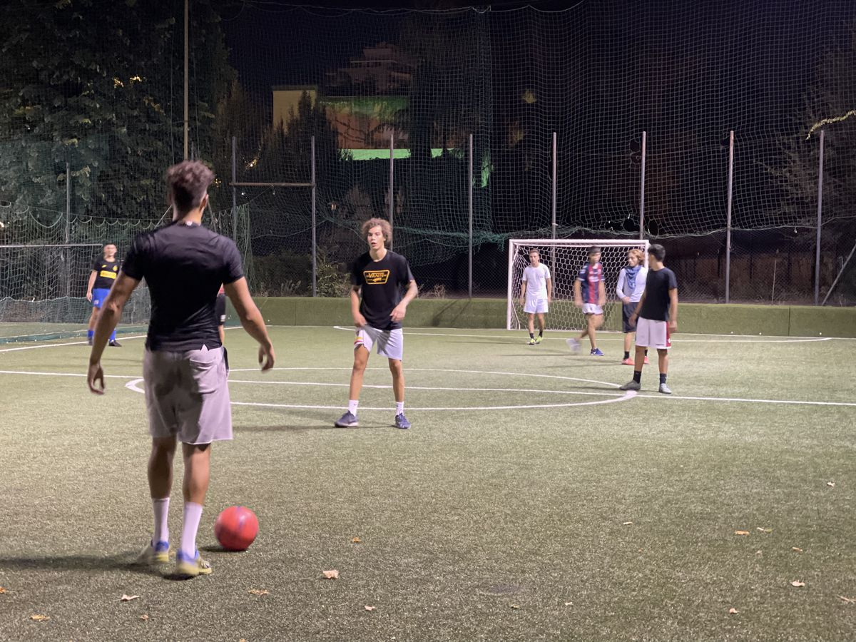 Italian men and boys play a game of five-on-five soccer in Bologna, Italy.