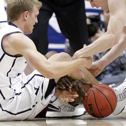 Brigham Young Cougars guard Tyler Haws (3) grabs a loose ball in Provo  Thursday, Jan. 3, 2013.