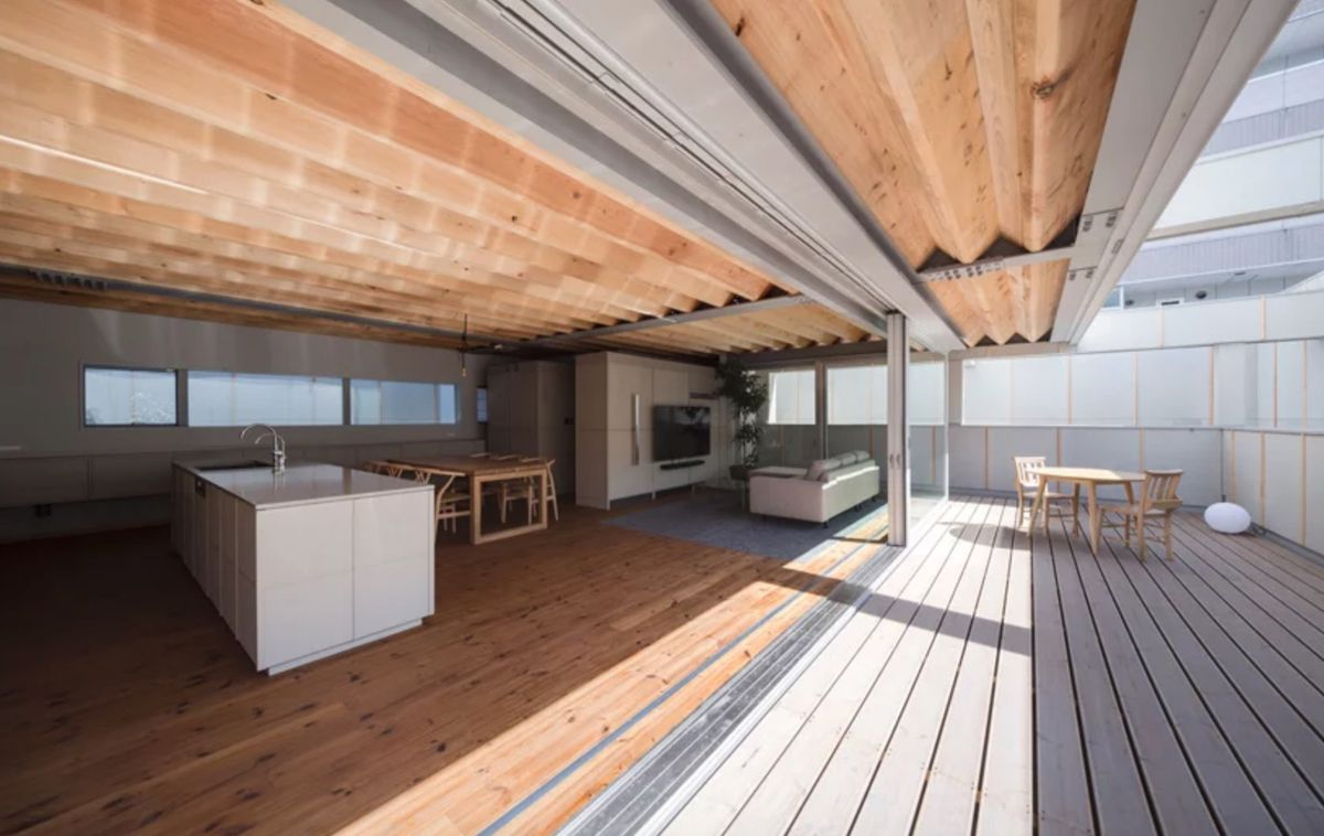 Outdoor terrace connected to kitchen area