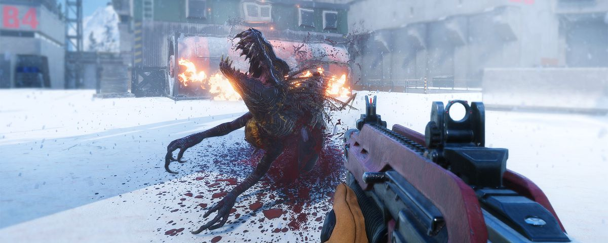 A dinosaur writhes, blood spattering the snow under it, with the player's assault rifle in the foreground