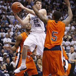 Jimmer Fredette of BYU looks to pass the ball around Julyan Stone of UTEP. Brigham Young University played the University of Texas at El Paso in NCAA basketball in Provo, Utah, Thursday, Dec. 23, 2010. (Ravell Call, Deseret News)