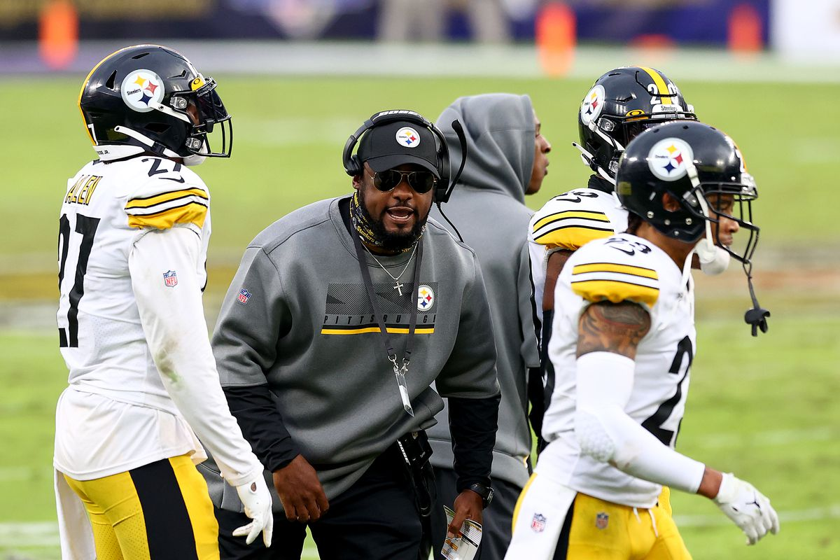 Head coach Mike Tomlin of the Pittsburgh Steelers celebrates with the defense after stopping the Baltimore Ravens on fourth down late in the fourth quarter at M&T Bank Stadium on November 01, 2020 in Baltimore, Maryland.