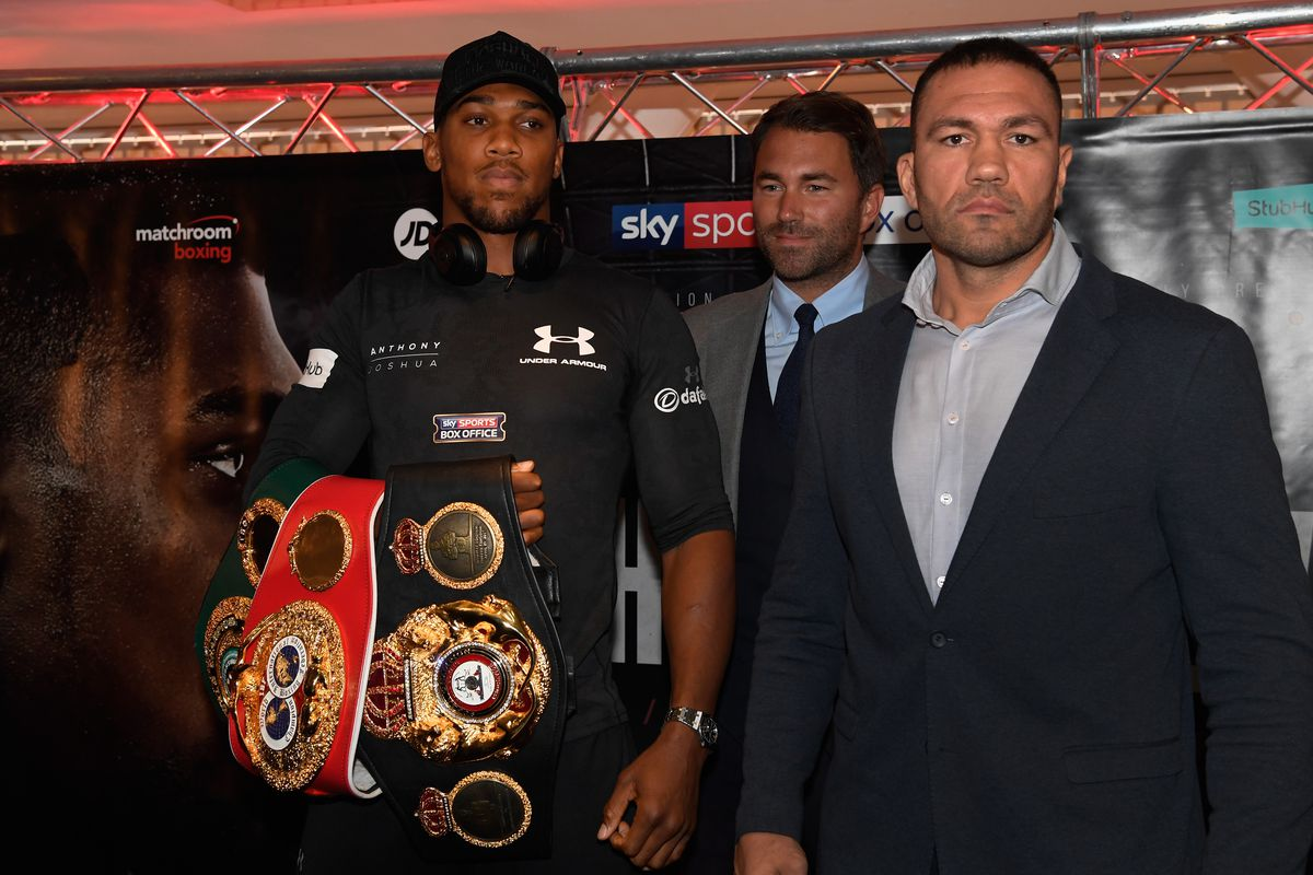 Anthony Joshua and Kubrat Pulev pictured with promoter Eddie Hearn during a media opportunity ahead of their World Heavyweight title clash at Principality Stadium on September 11, 2017 in Cardiff, Wales.