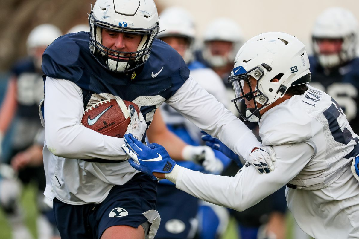 Tight end Isaac Rex moves the ball past linebacker Isaiah Kaufusi during a Brigham Young University football practice in Provo on Friday, March 6, 2020.