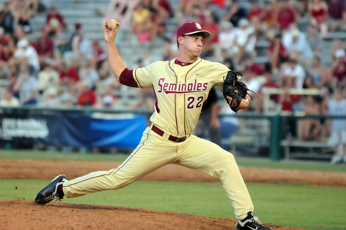 June 3, 2012; Tallahassee, FL, USA; Florida State Seminoles pitcher Robert Benincasa (22) pitches the ball during the ninth inning in game six of the Tallahassee regional at Dick Howser Stadium.  Mandatory Credit: Melina Vastola-US PRESSWIRE