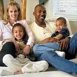 Sindi and Thurl Bailey relax in their Sandy home with BreElle, 7, and Brendan, 5.