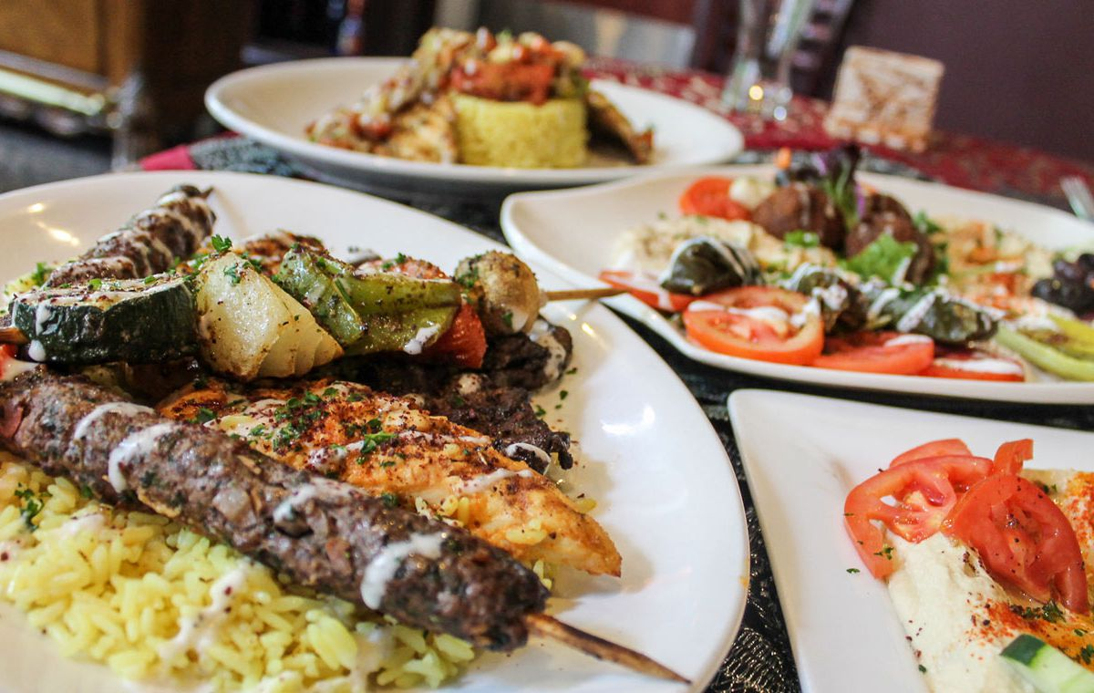 Plates with kebabs and rice.