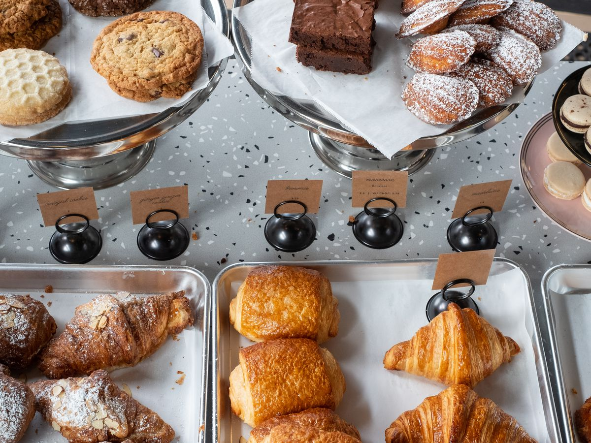 A spread of scones, cookies, croissants, madelines, brownies, and macaron