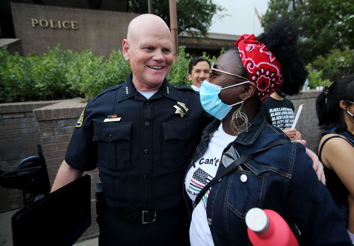 Provo Police Chief Rich Ferguson laughs and talks with Tamu Smith during a vigil organized by Unified Allies 4 Change at the Provo Police Department on Friday, June 5, 2020, for all those who have lost their lives to police brutality.