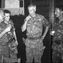 FILE - In this July 12, 1995 file photo, Bosnian Serb army Gen. Ratko Mladic drinks with Dutch commander Col. Thom Karremans at a meeting a day before Dutch U.N. peacekeepers evacuated Bosnian Muslims from the troops' compound in Srebrenica. A Dutch appeals court ruled on Tuesday, June 27, 2017, that the Dutch state is partially liable in the deaths of about 300 Bosnian Muslim men killed by Mladic's forces in the 1995 Srebrenica massacre. Karremans was the commander of Dutch peacekeepers at Srebrenica.