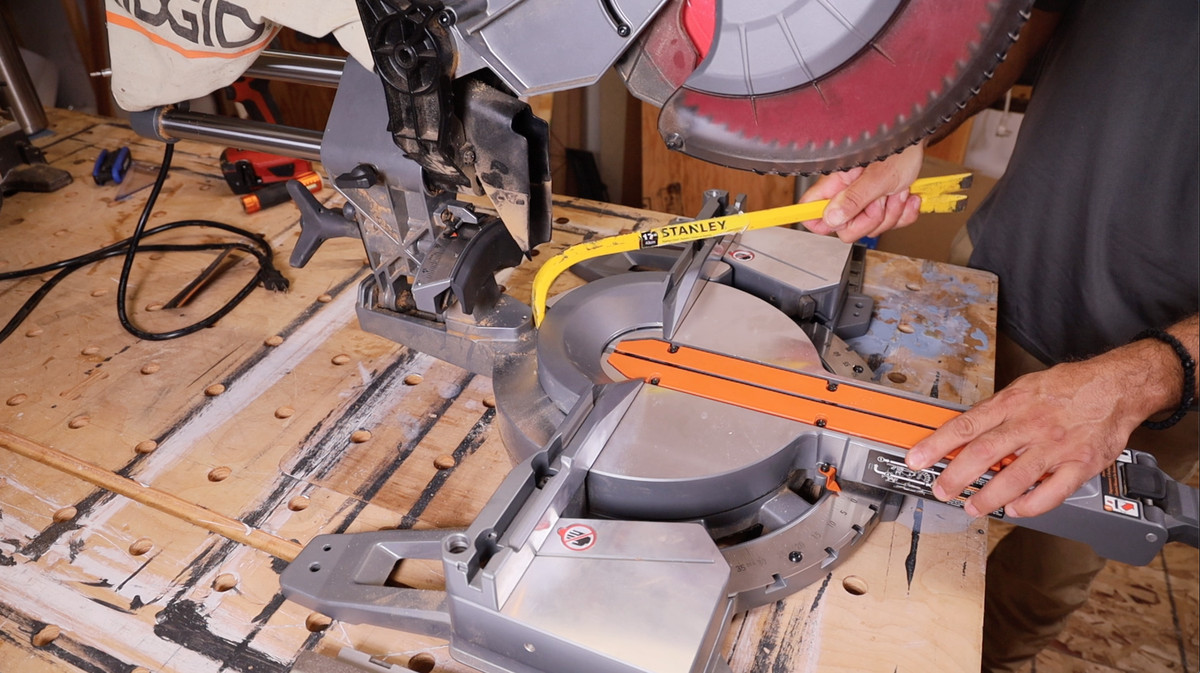 Aligning the fence of a miter saw