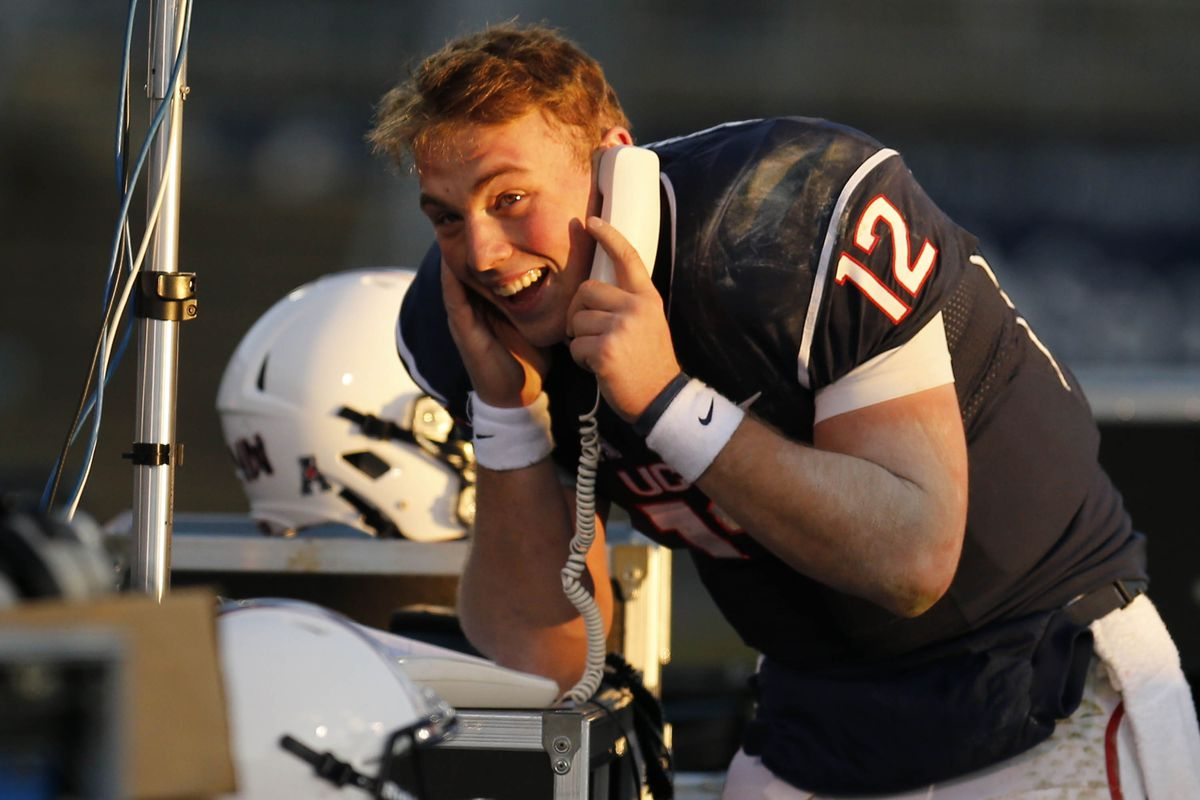 UConn quarterback Casey Cochran orders pizza to celebrate a 45-10 thumping of Memphis.