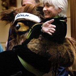 Utah Sen. Pat Jones, D- Salt Lake, is lifted by the Jazz Bear during a ceremony honoring recently retired Jazz coach Jerry Sloan at the Utah State Capitol on March 7, 2011.