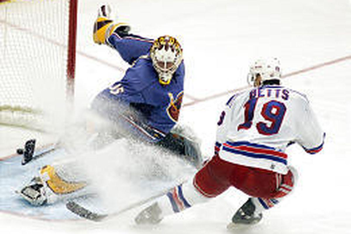 Blair Betts of the New York Rangers scores against Atlanta goalie Michael Garnett during the third period of Thursday's 6-3 victory.