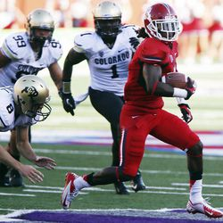 Fresno State's Isaiah Burse returns a kick past Colorado's Darragh O'Neill, Nare Bonsu and Derrick Webb in the first quarter of an NCAA college football game in Fresno, Calif., Saturday, Sept. 15, 2012.