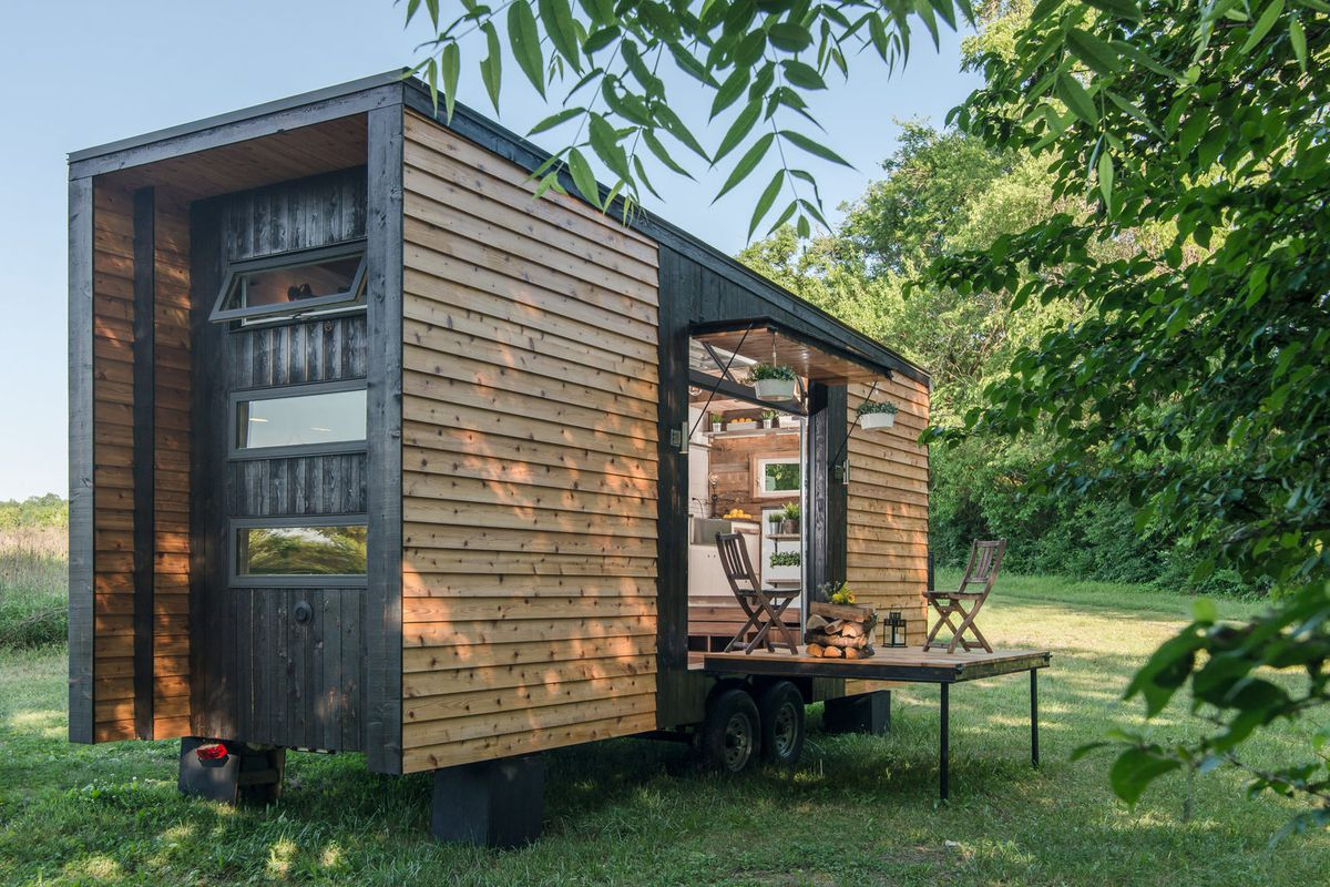 Tricked out tiny home features garage door and custom deck Small house garage