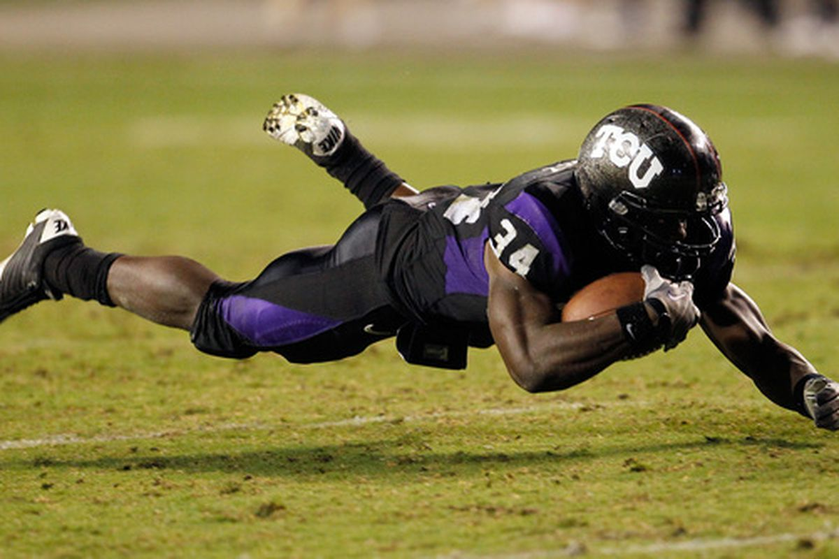 FORT WORTH TX - OCTOBER 23:  Tailback Ed Wesley #34 of the TCU Horned Frogs carries the ball against the Air Force Falcons at Amon G. Carter Stadium on October 23 2010 in Fort Worth Texas.  (Photo by Tom Pennington/Getty Images)