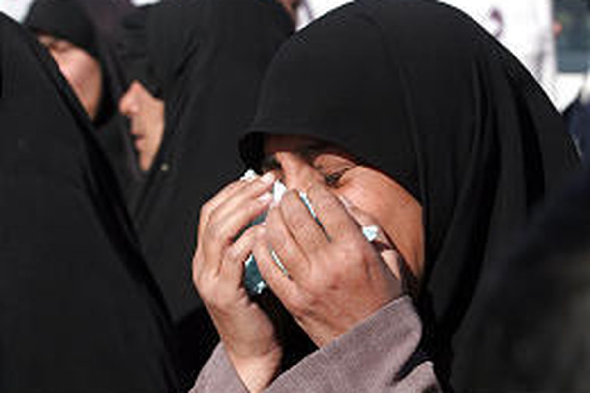 A woman cries in front of Iraq's Human Rights Ministry in Baghdad. Iraqis were protesting over missing relatives.