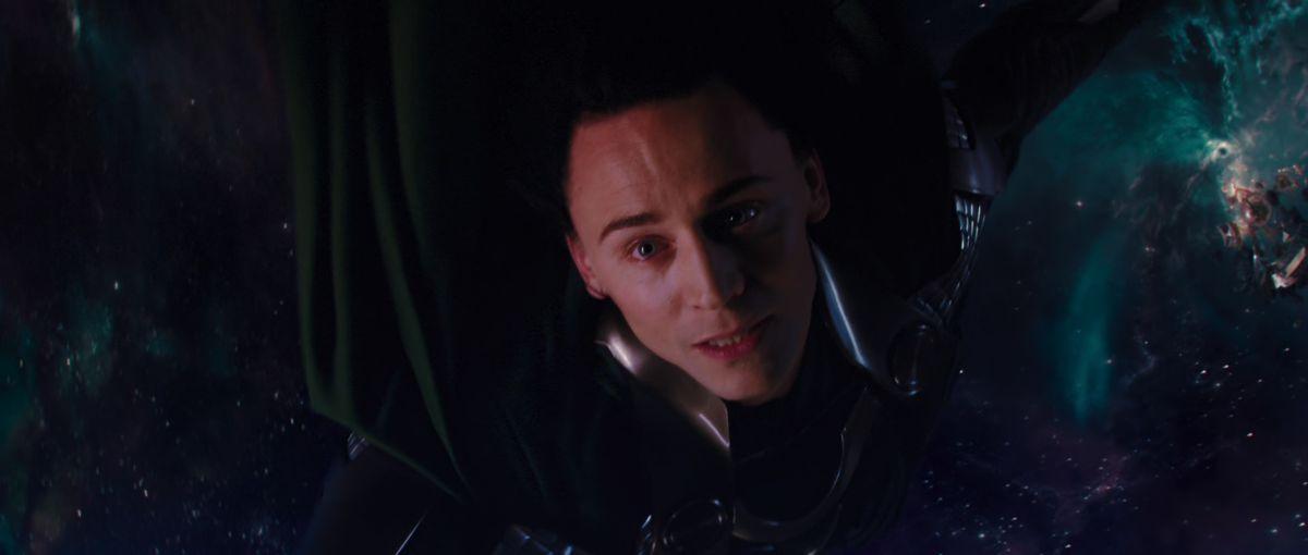 Loki hangs from the Rainbow Bridge in Thor (2011).