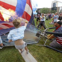 Spencer Kehl inflates the Stars and Stripes balloon for display during Balloon Fest at Bulldog Field in Provo on Friday, July 2, 2021. The balloons could not fly due to weather but were inflated for display.