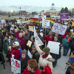 Supporters of equal marriage rights gather for a rally Tuesday, Jan. 28, 2014, on the front steps of the Utah State Capitol.