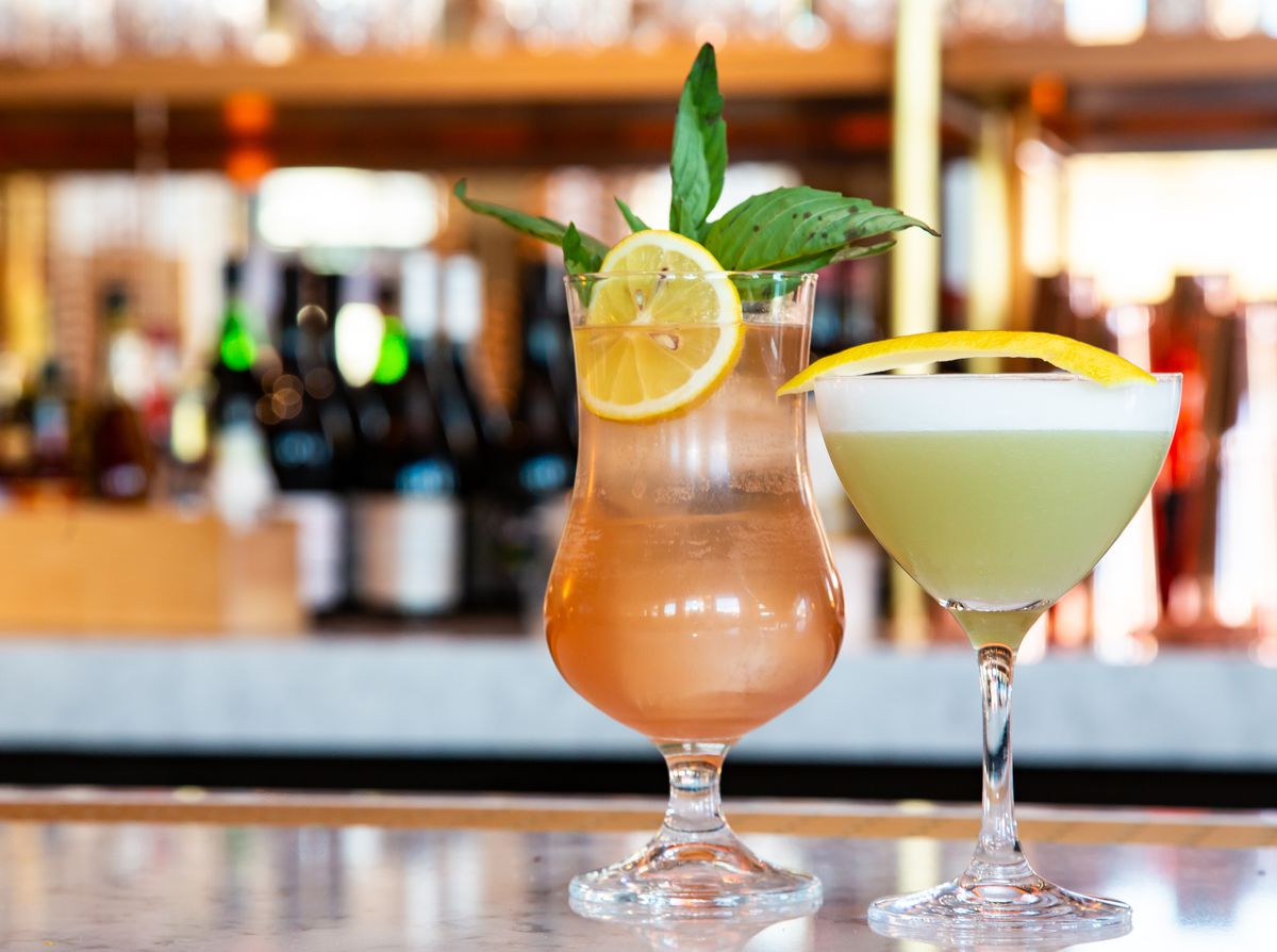 From left to right: Dots & Loops with sparkling wine, Génépy, apple brandy, lemon, and honey and Prince of the Sun with gin, lemon, Comoz Blanc, violette, suze, and whey