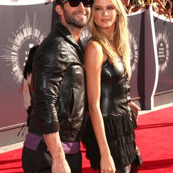 Adam Levine and Behati Prinsloo. The couple that leathers together...