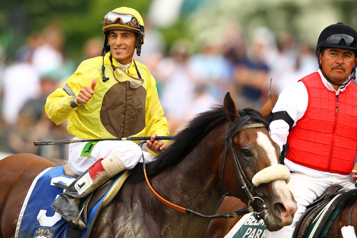 ELMONT, NY - JUNE 09:  John Velasquez, Jockey of Union Rags celebrates his victory  during the 144th running of the Belmont Stakes at Belmont Park on June 9, 2012 in Elmont, New York.  (Photo by Al Bello/Getty Images)