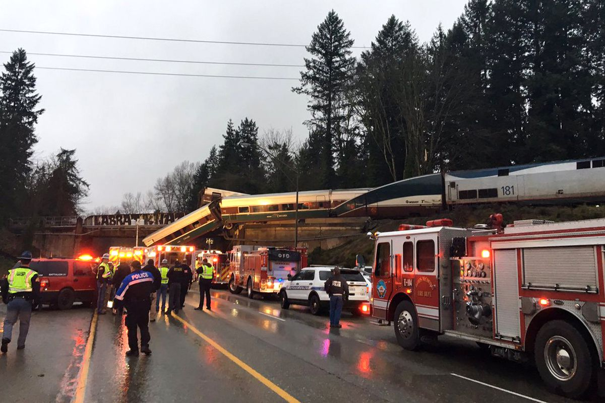 """This photo provided by Washington State Patrol shows an Amtrak train that derailed south of Seattle on Monday, Dec. 18, 2017. Authorities reported """"injuries and casualties."""" The train derailed about 40 miles (64 kilometers) south of Seattle before 8 a.m.,"""