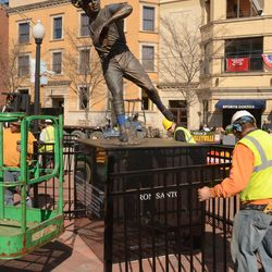 3:42 p.m. Workers reinstalling the Ron Santo statue -