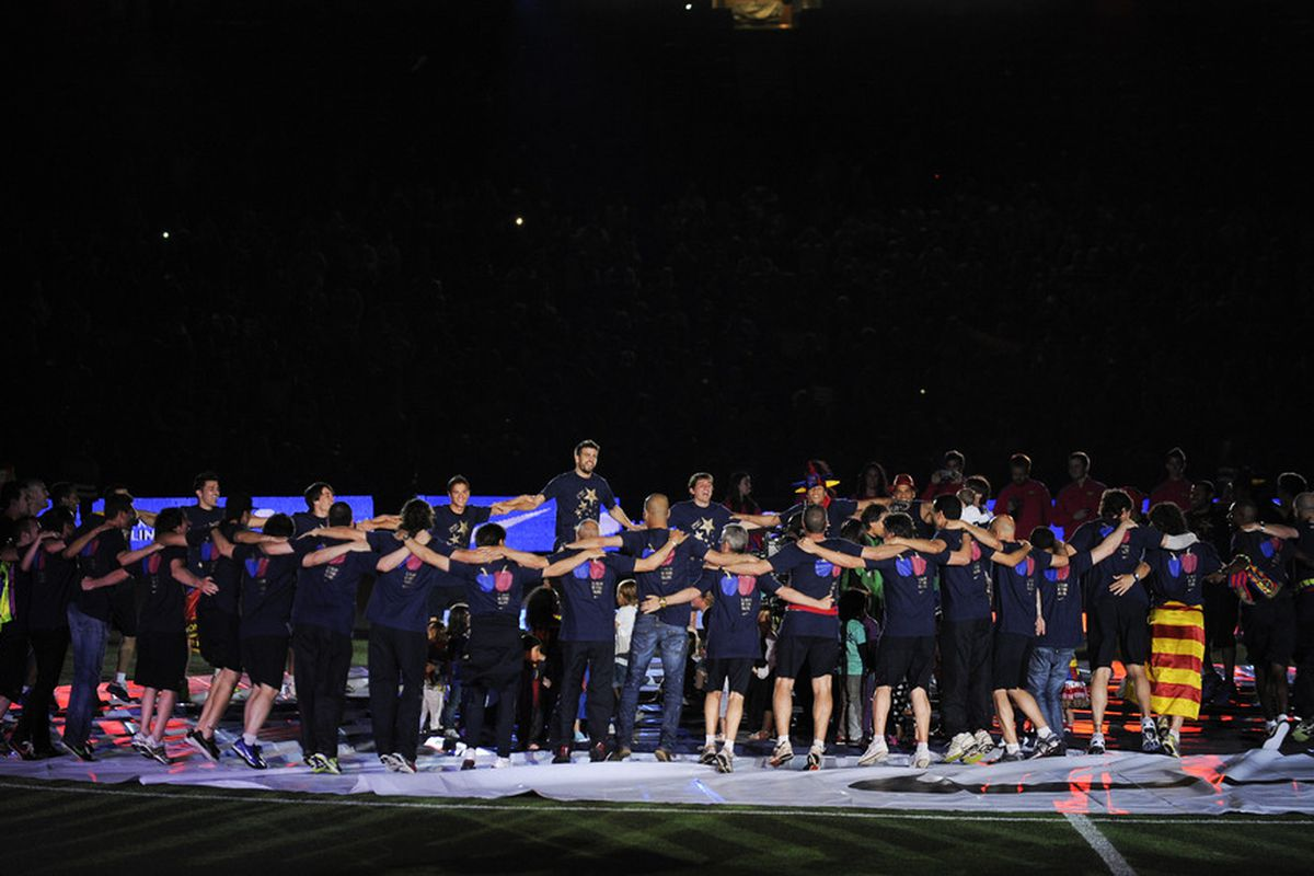 BARCELONA, SPAIN - MAY 13:  FC Barcelona players celebrate during the celebrations for winning the Spanish Liga at the Camp Nou Stadium on May 13, 2011 in Barcelona, Spain.  (Photo by David Ramos/Getty Images)