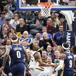 After he was fouled on the shot Utah Jazz guard Donovan Mitchell (45) watches to see if the basket sinks as Utah hosts New Orleans at Vivint Arena in Salt Lake on Friday, Dec. 1, 2017.