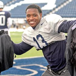 Utah State senior cornerback Jalen Davis poses for photos after receiving some of his swag for the NOVA Home Loans Arizona Bowl at the end of practice on Dec. 19.