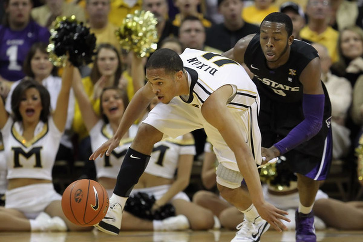 COLUMBIA MO - JANUARY 17:  Michael Dixon #11 of the Missouri Tigers battles Jacob Pullen #0 of the Kansas State Wildcats for a loose ball during the game on January 17 2011 at Mizzou Arena in Columbia Missouri.  (Photo by Jamie Squire/Getty Images)