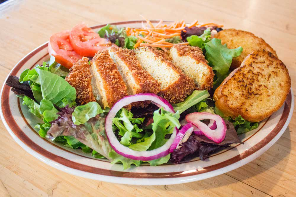 Pictured is a faux chicken salad from Wayward Vegan Cafe.