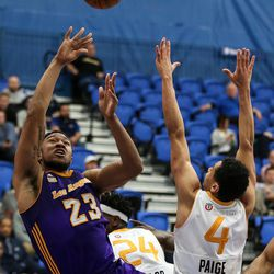 Los Angeles D-Fenders forward Justin Harper (23) shoots over Salt Lake City Stars guard Marcus Paige (4) at the Lifetime Activities Center in Taylorsville on Wednesday, Feb. 08, 2017.
