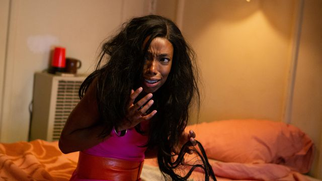 Elle Lorraine cries and clutches her long, matted hair in Bad Hair