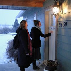 Sister Danielle Ward, 19, of West Jordan, Utah, knocks on doors in Bozeman, Mont., with her missionary companion, Sister Elizabeth Pattullo of Newberg, Ore.