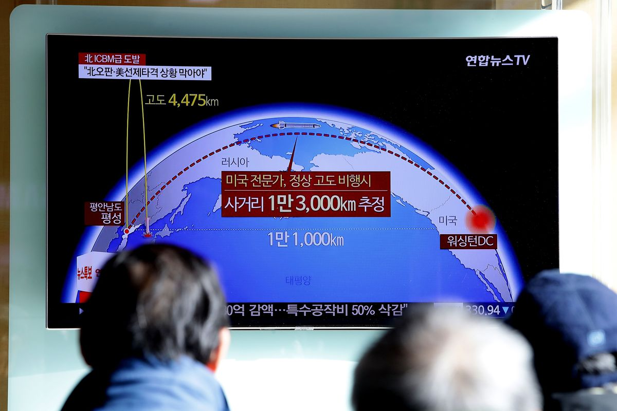 People watch a television broadcast, reporting North Korea's test-launch of its new missile, at the Seoul Railway Station on November 29, 2017 in South Korea.