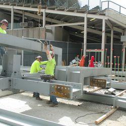 2:57 p.m. Right-field video board framework being assembled -