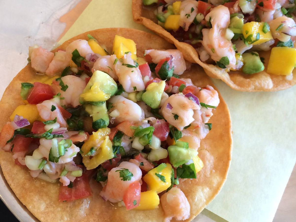 Two corn tortillas with seafood