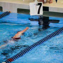 A swimmer completes her seventh lap at the 3A women's swimming state meet at the South Davis Recreation Center in Bountiful on Saturday, Feb. 13, 2021.