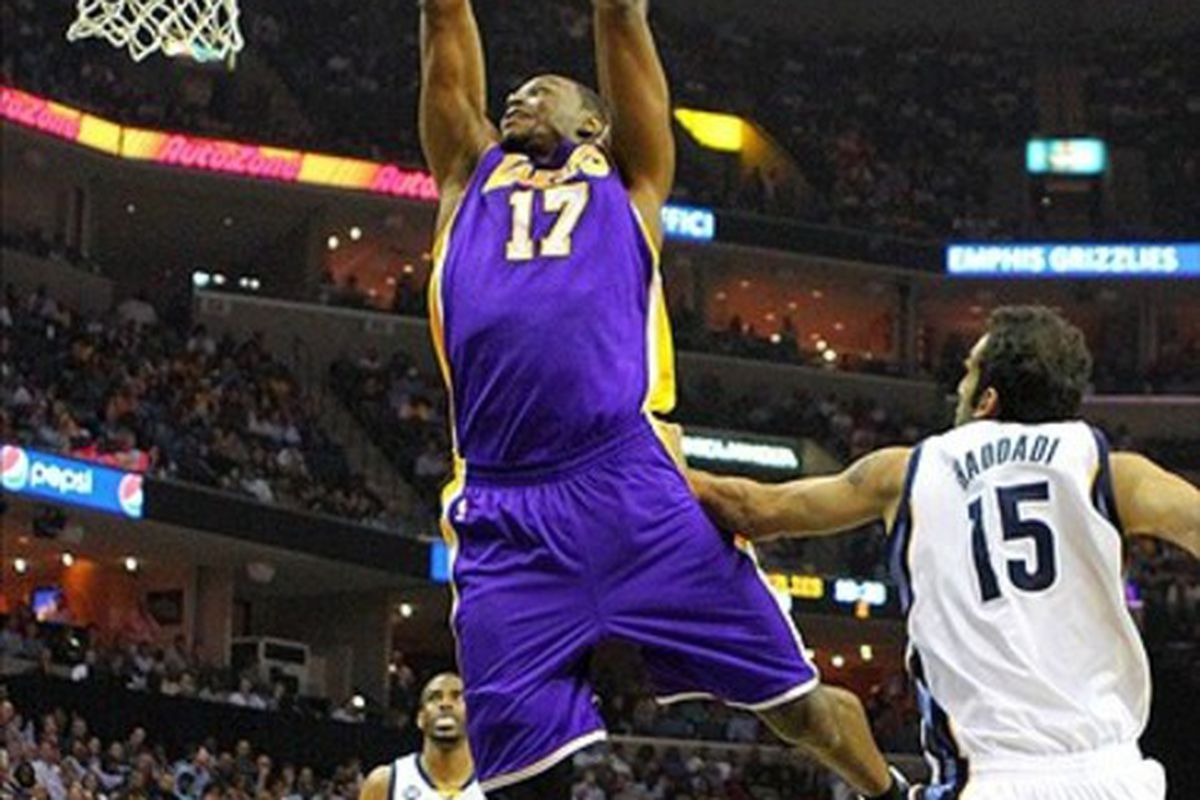 Mar 13, 2012; Memphis, TN, USA;  Los Angeles Lakers center Andrew Bynum (17) dunks the ball during the first half against the Memphis Grizzlies at the FedEx Forum.  Mandatory Credit: Spruce Derden-US PRESSWIRE