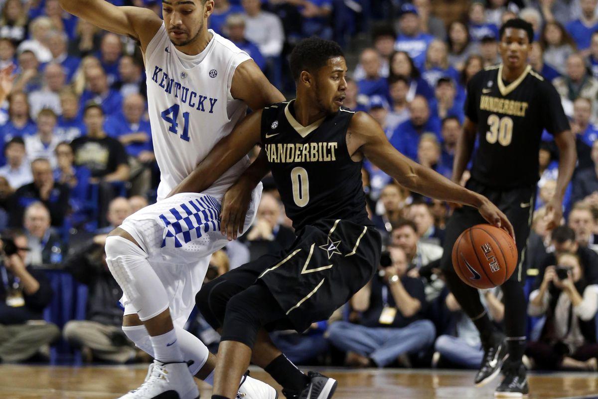 Vanderbilt's Shelton Mitchell fouls Kentucky's Trey Lyles according to eye witness reports.
