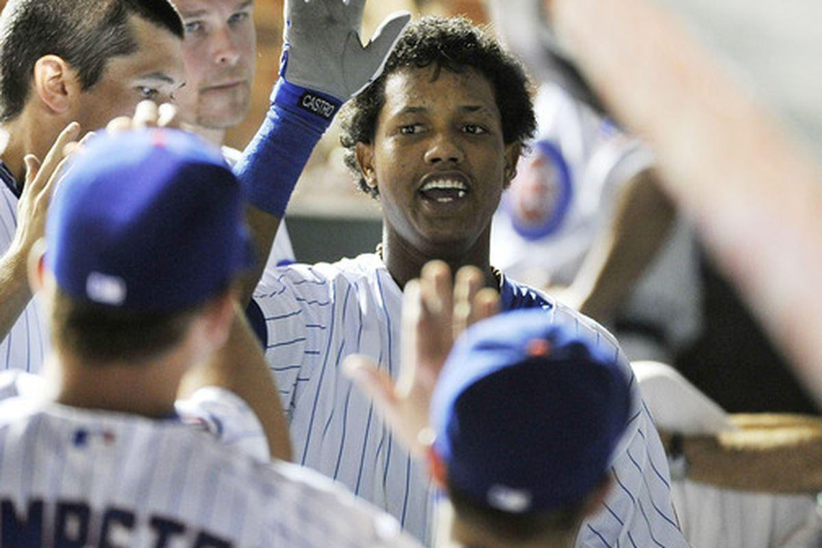 Starlin Castro of the Chicago Cubs is greeting by his teammates in the dugout after hitting a solo home run during the eighth inning against the Washington Nationals at Wrigley Field in Chicago, Illinois.  (Photo by Brian Kersey/Getty Images)