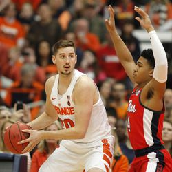 Syracuse's Tyler Lydon, left, looks to pass the ball under pressure from Mississippi's Breein Tyree during NIT game in Syracuse, N.Y., Saturday, March 18, 2017. Lydon was in Salt Lake City on Monday, showing off his skills to Jazz brass.