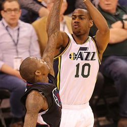 Utah Jazz guard Alec Burks (10) puts in a shot over Los Angeles Clippers guard Jamal Crawford (11) as the Utah Jazz and the LA Clippers play at Vivint Smart Home Arena Friday, April 8, 2016.