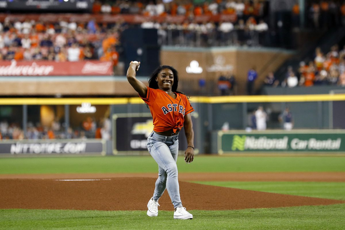 Gymnast Simone Biles throws out the ceremonial first pitch prior to game two of the 2019 World Series between the Houston Astros and the Washington Nationals at Minute Maid Park in 2019 in Houston, Texas.